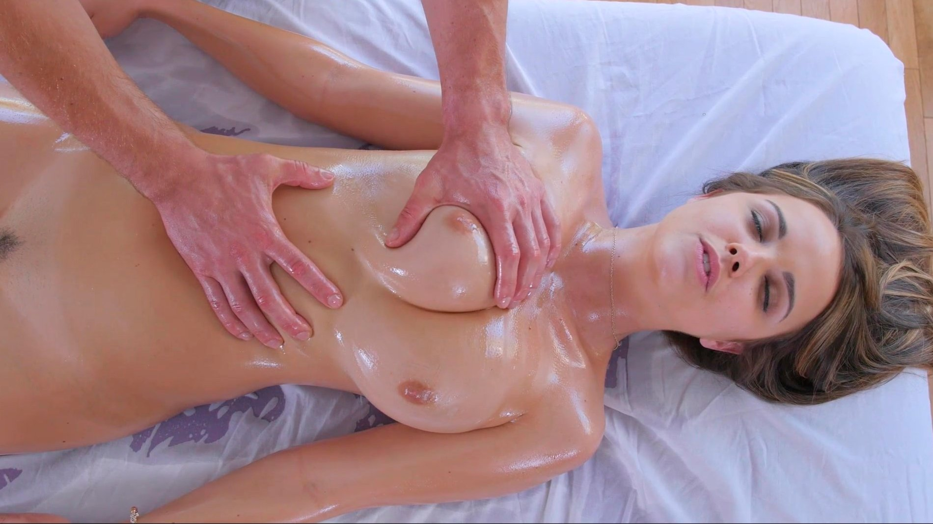 Chick with big breasts massaging and masturbating pussy shower